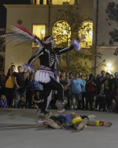 Dancers from the Toyaacan La Puente Aztec dance group performing an Aztec dance at the Día de Los Muertos celebration held at the quad at Fullerton College in Fullerton on Oct. 29 Photo credit: Neddie Facio