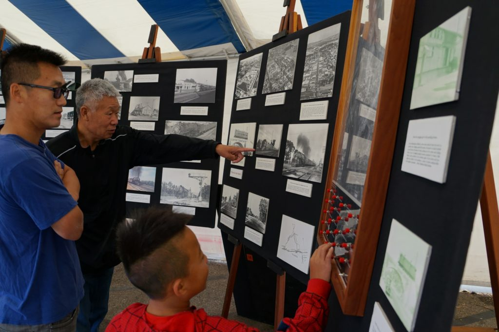 Family looks at historic railroad pictures
