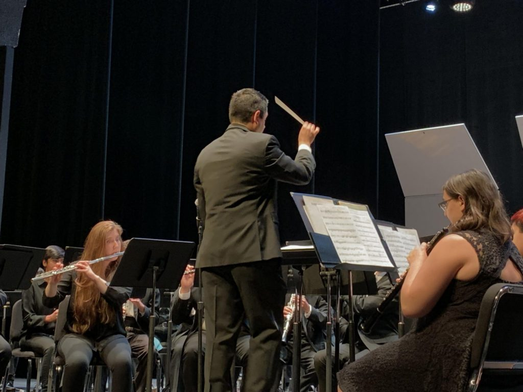 Director Lopez leading the band on Tuesday April 30th.