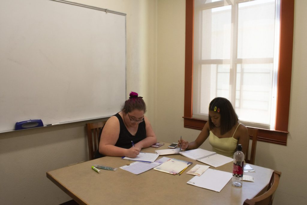 FC students Mariah Russell and Trinity Lobe studying in a study room