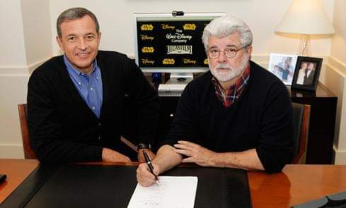 Bob Iger and George Lucas agreeing to the Disney acquisition of Star Wars. circa 2012