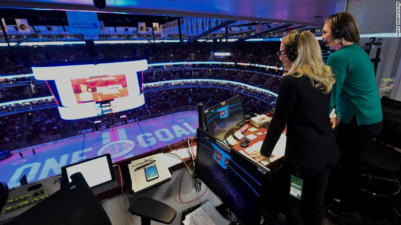 Kate Scott and AJ Mleczko in the booth at Blackhawks and Blues game.