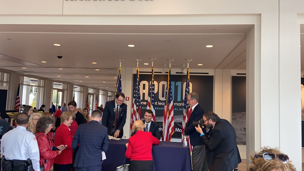 """Charlie Kirk, Turning Point USA founder, signs copies of his book, """"The MAGA Doctrine"""" in the lobby of the Nixon Library in Yorba Linda"""