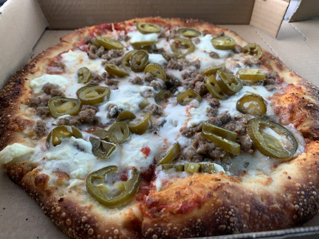 The Build Your Own Bowery Pizza which consisted of Italian sausage, jalapeños, and ricotta cheese.