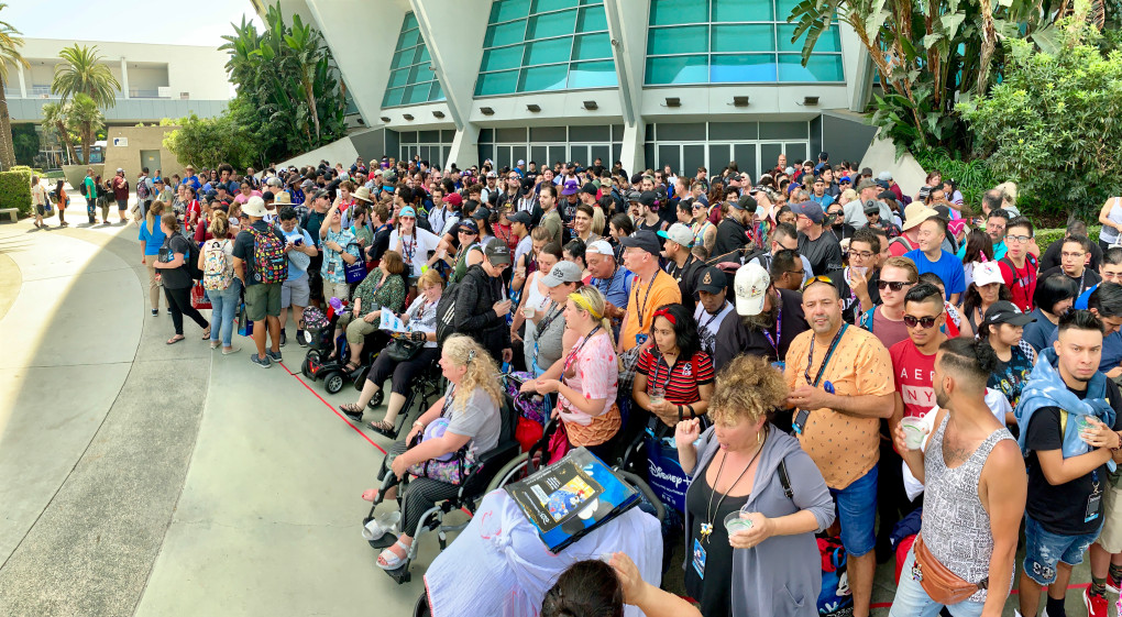 Hundreds of people wait to go to an overnight holding area at the Anaheim Convention Center before the D23 Expo in Anaheim, CA, on Thursday, Aug. 22, 2019. The expo goers will spend the night waiting for the event to start on Friday.