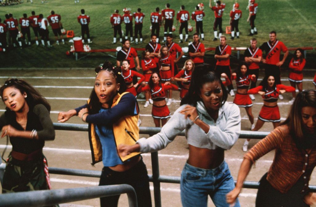 The East Compton Clovers cheerleaders attend the Toros football game.