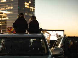 Orange County residents experience the new drive-in movie experience at the Irvine Spectrum Center.