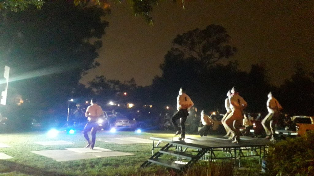 Cars flash their lights in appreciation for Ballet Folklorico.