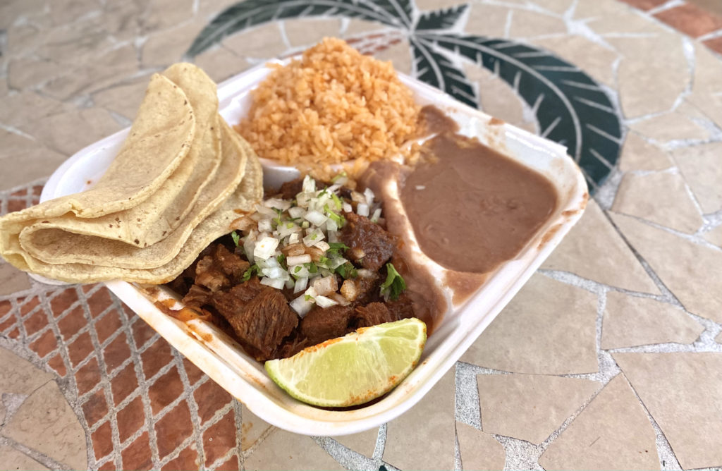 One of the many dishes that El Camino Real offers, the birria or beef stew, is served alongside rice, beans and tortillas.