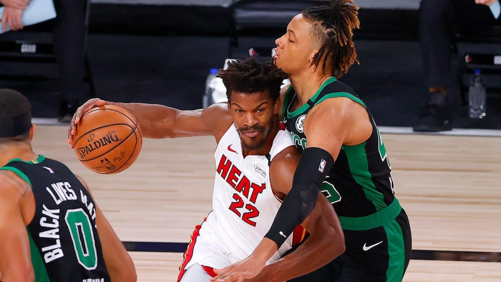 Jimmy Butler of the Miami Heat pushing up against Romeo Langford of the Celtics.