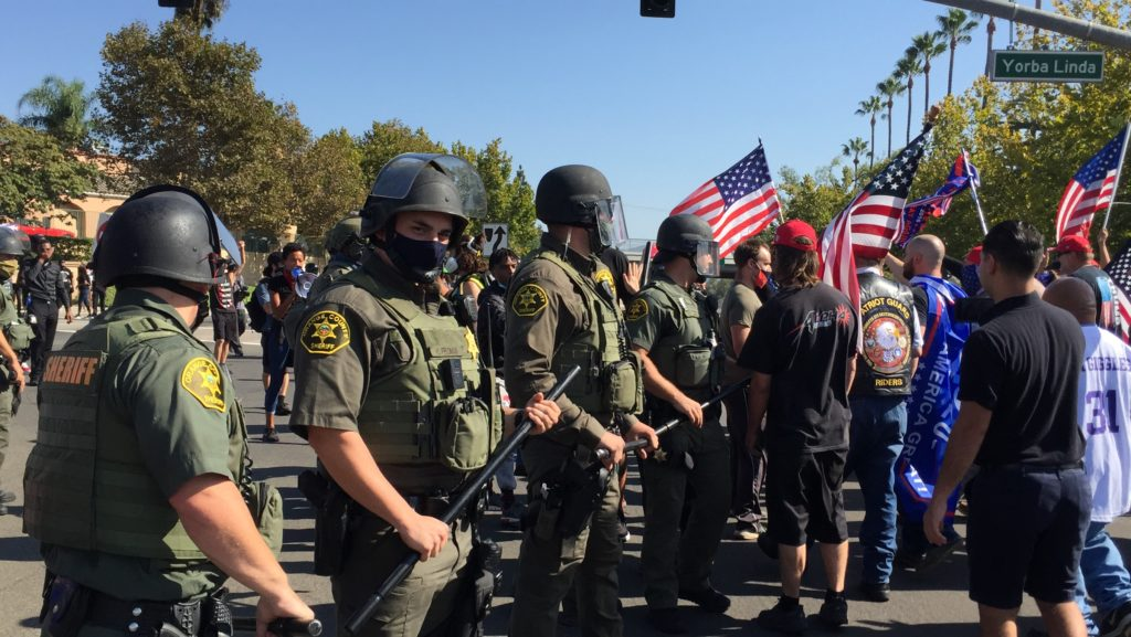 The Sheriff's form a line on the intersection of Yorba Linda Blvd. and Imperial Hwy. Police were able to temporarily keep away the Trump supporters from BLM protestors