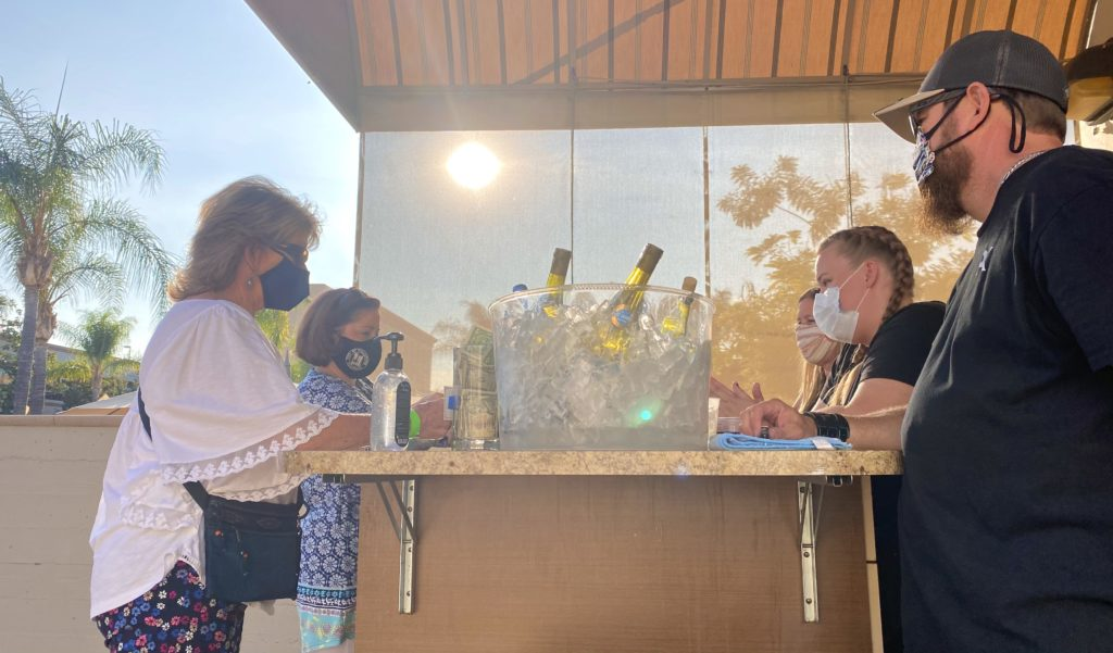 Members of the Vino Nostra staff served drinks to the event goers led by owner Dena David.