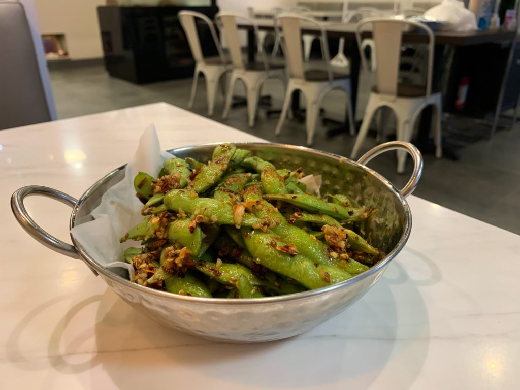 A side of edamame sauteed with garlic and chili oil.