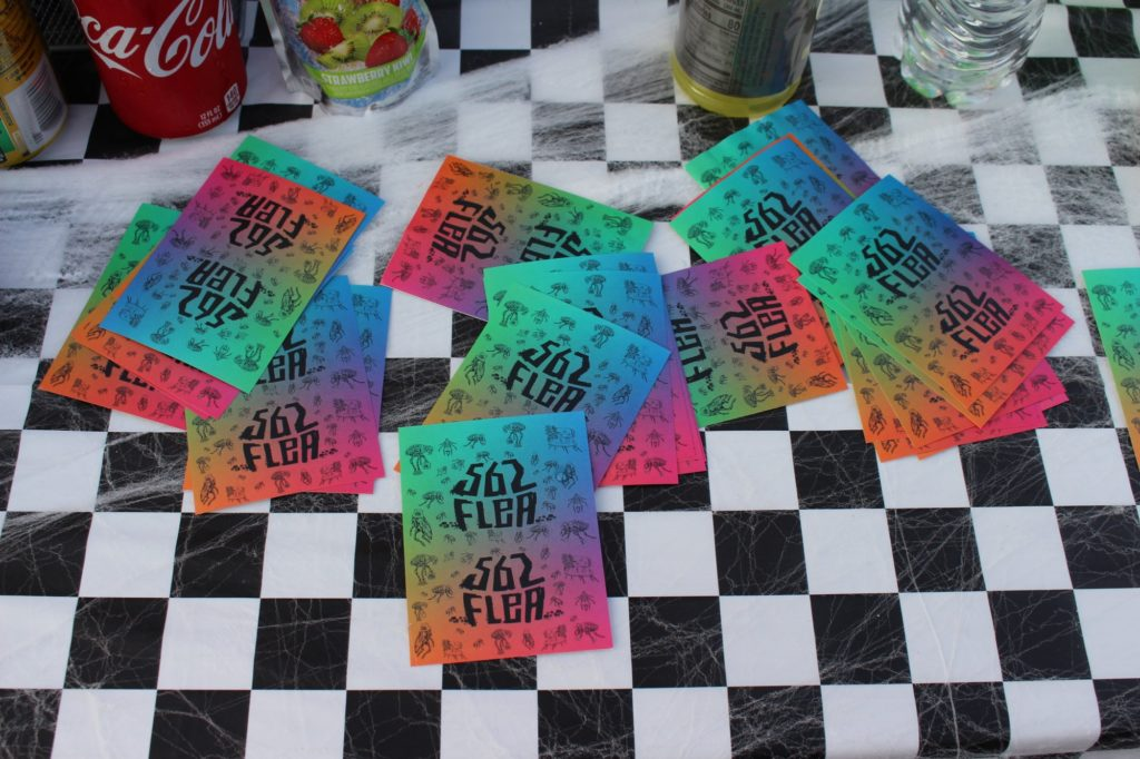 @562flea stickers were offered for free at the snack bar of the event.