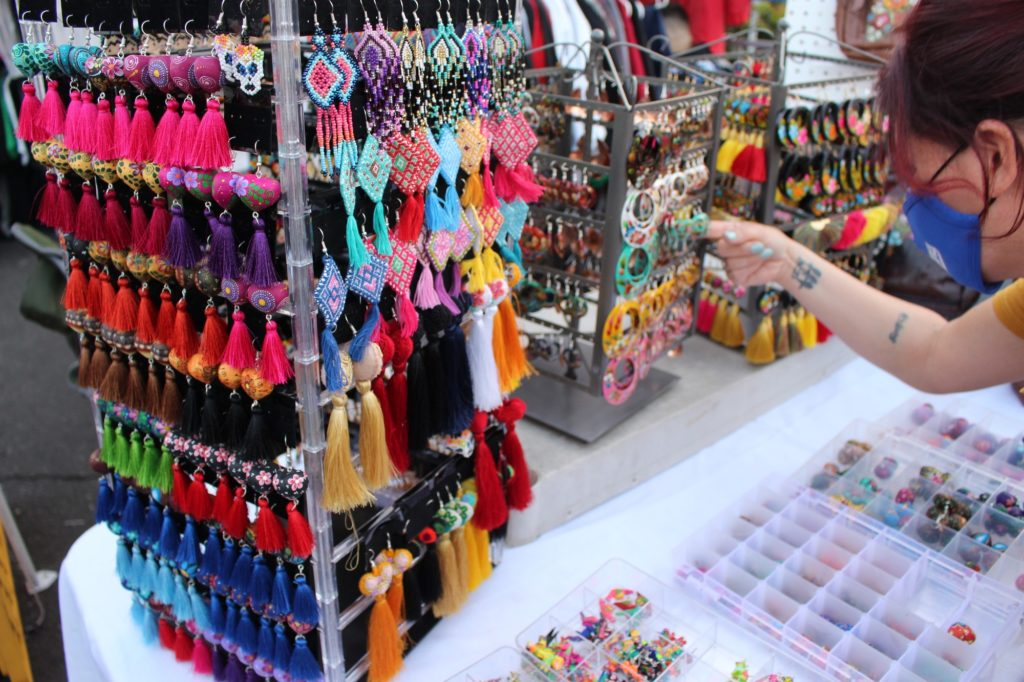 A person looking at the details in the handmade jewelry from Mexico.