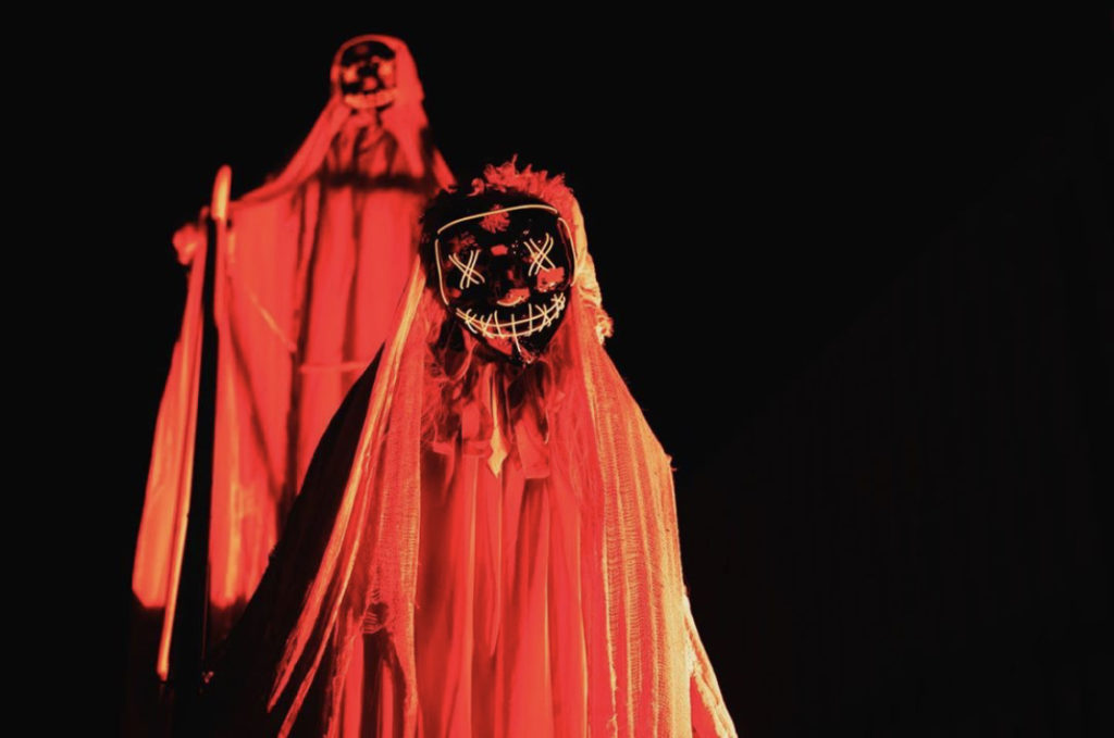 Some glowing masked mannequins placed throughout the event to provide a scarier experience.
