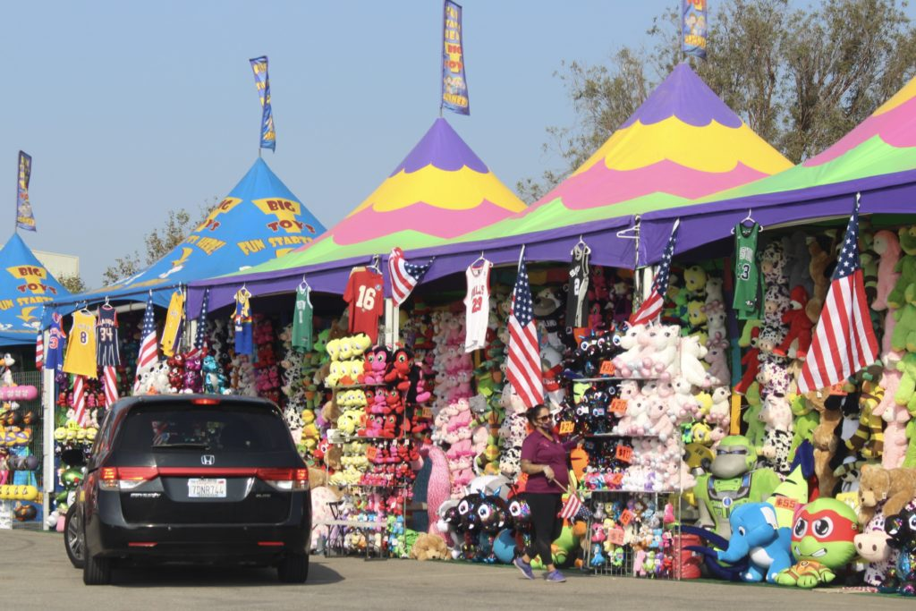 The Fair Foodie Fest offers carnival game prizes for sale and a ring toss to win prizes from your car.