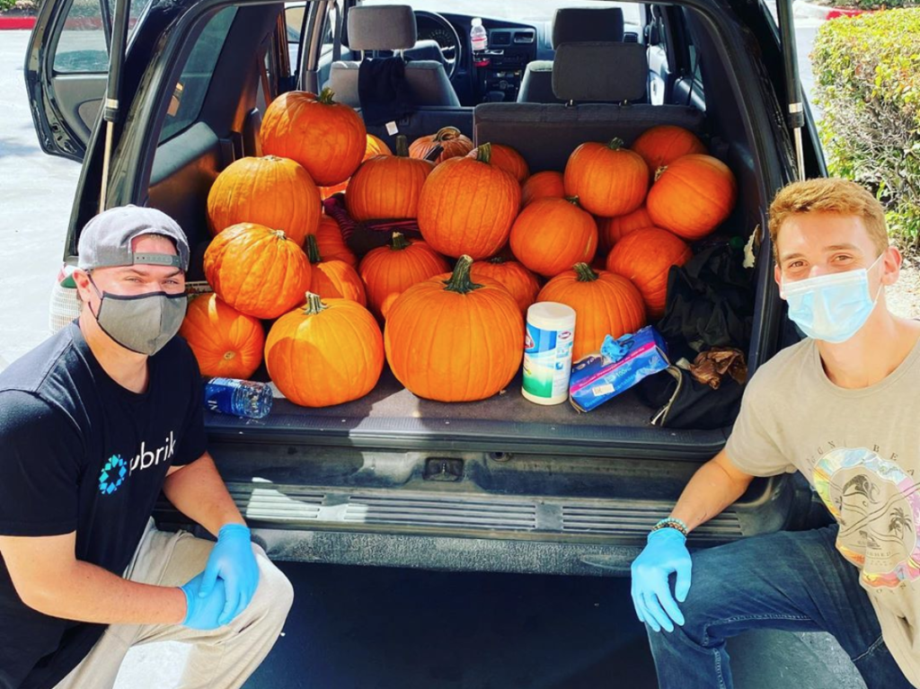 Founder Luke Derentz and Financial Director Austin Charrette out on their first day delivering pumpkins.