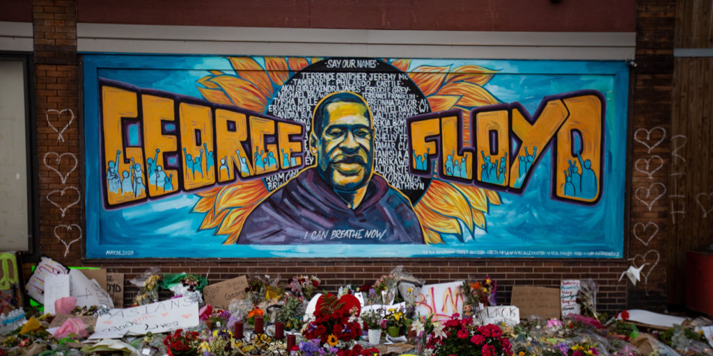 "A mural in Minneapolis, MN, the city where George Floyd died, includes a painting of Floyd, his name, the names of other police brutality victims and the words, ""I can breathe now."""