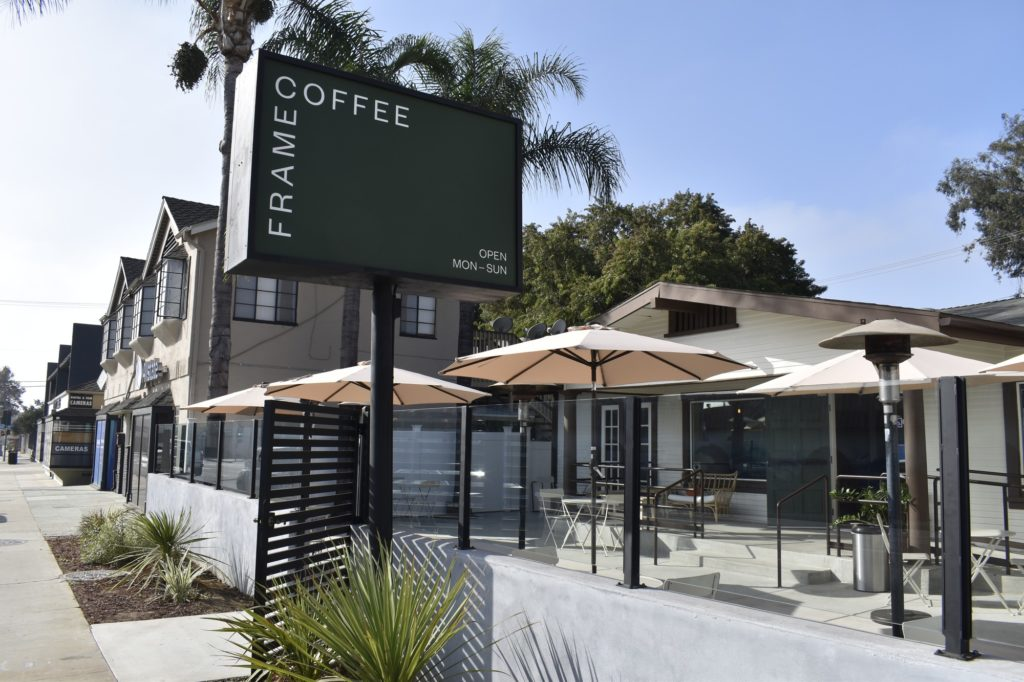 An outdoor view of Frame Coffee shop that shows the outdoor patio.