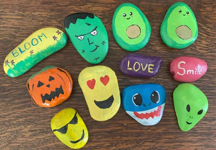 These painted rocks feature bright colors and friendly faces.
