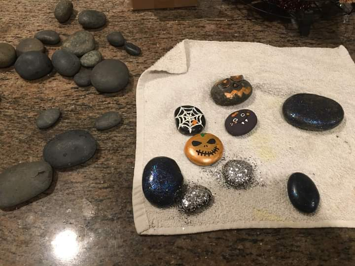 Before and After Halloween style painted rocks.