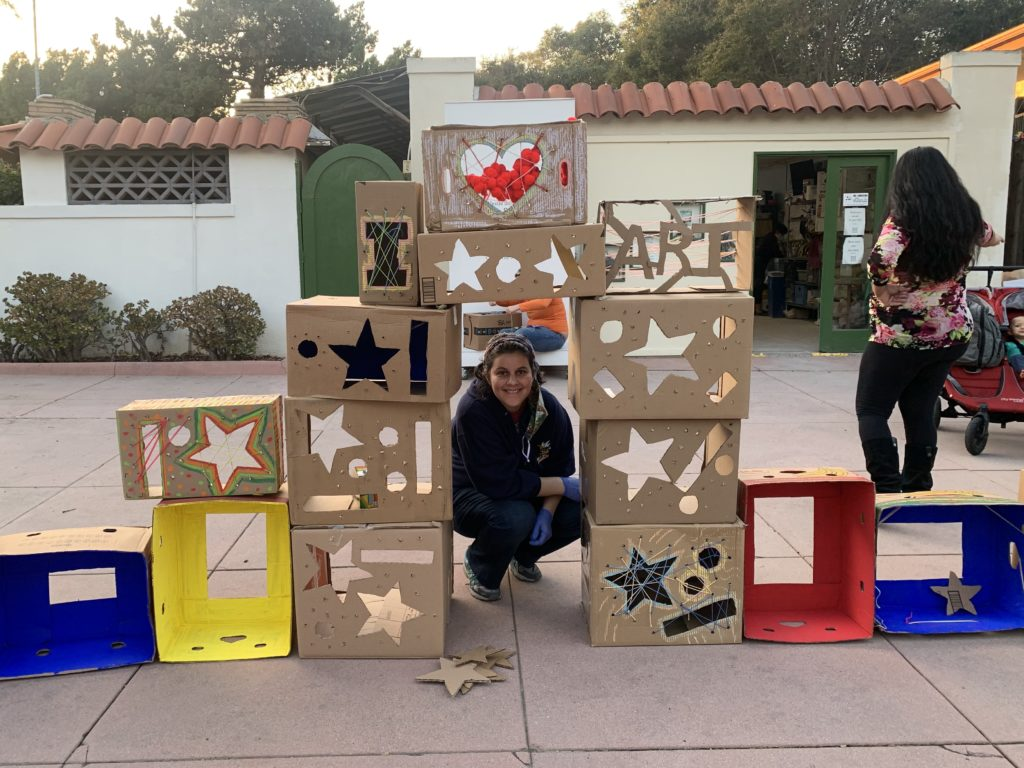 Sarah Clifton poses with her cardboard art creation.