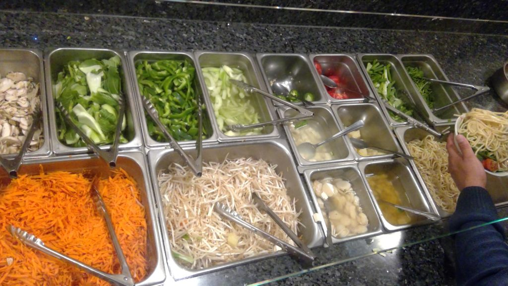 The variety of vegetable toppings to chose from at Mad Wolf's self-serving bowl bar.
