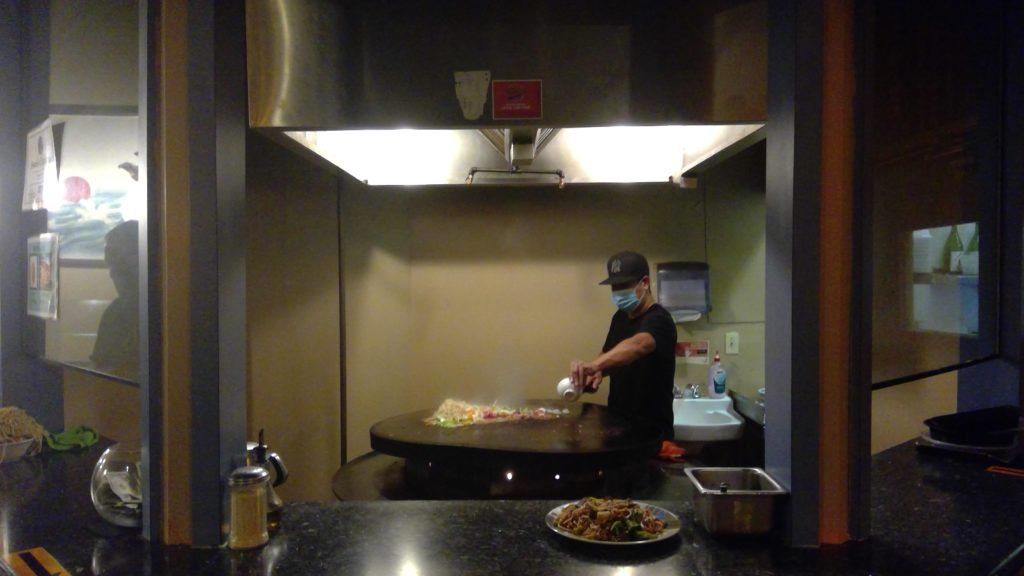 Chef cooking mongolian barbecue at mad wolf