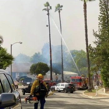 Fullerton Fire Department helping to put out fires in residential areas.