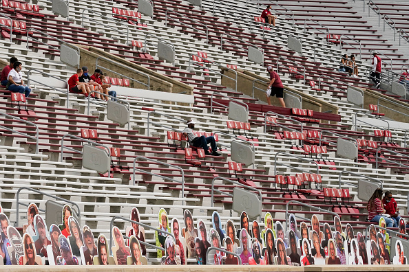 NORMAN, OK - SEPTEMBER 12: Early arriving fans wait for the Missouri State vs. Oklahoma NCAA college football game, socially distanced from other seating areas on September 12, 2020 in Norman, Oklahoma. Due to coronavirus (COVID-19) restriction, no fans are allowed in the first rows, only cut-outs. (Photo by Sue Ogrocki-Pool/Getty Images)