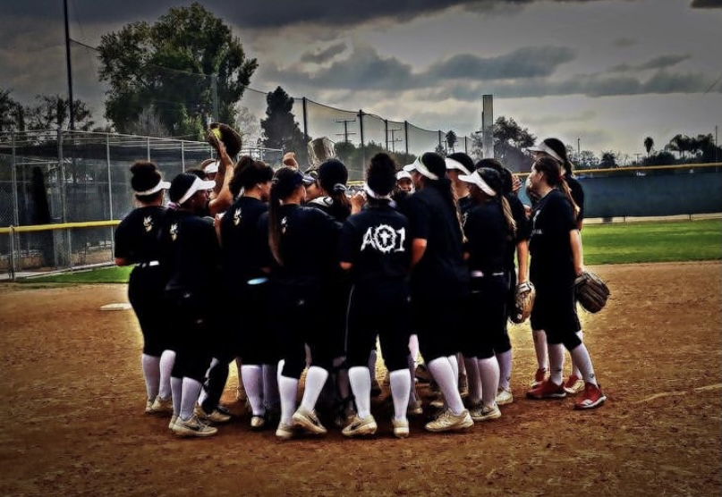Fullerton College Softball team huddled up at home plate.