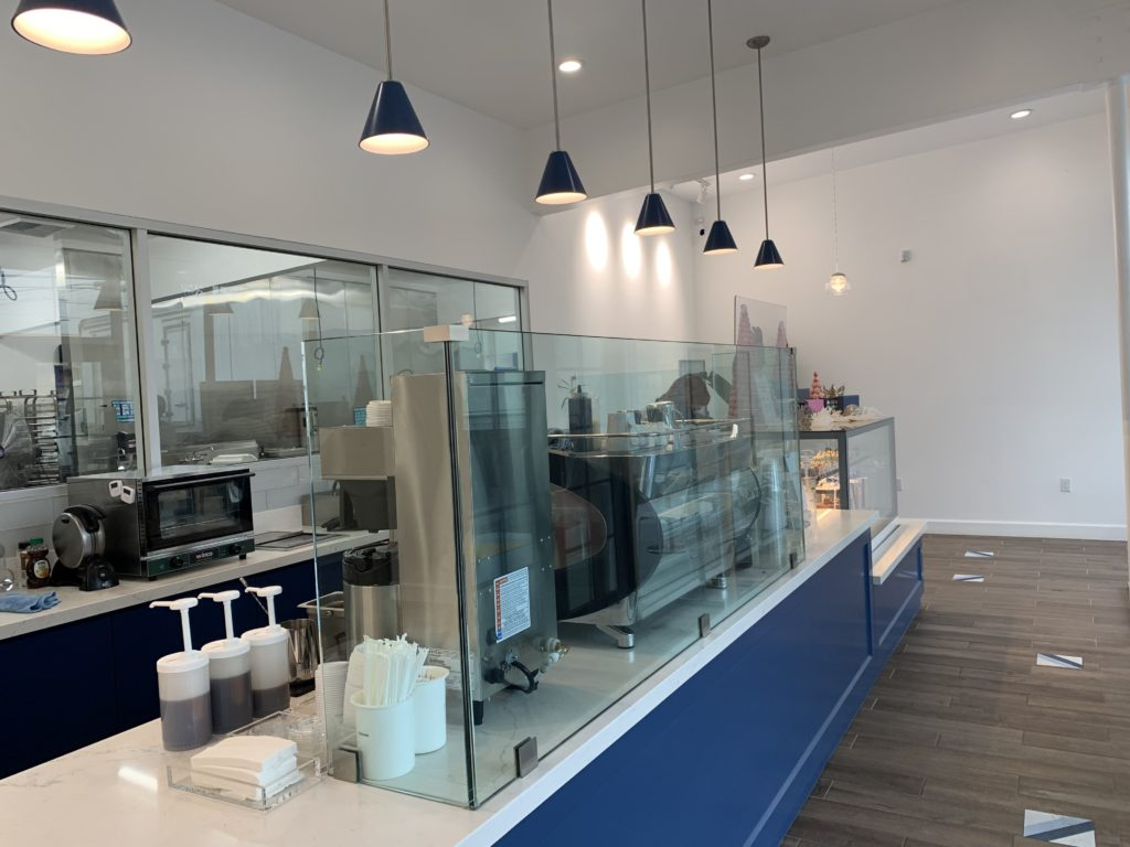 The remodeling of Kayla's Cake began in March of 2020. It features new flooring, lighting, paint and this modern blue and white counter space.