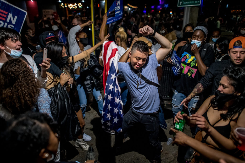 People dancing and celebrating Biden and Harris winning the 2020 election
