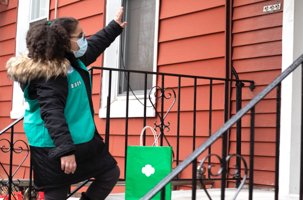 Girl Scout safely delivers cookies to neighborhood