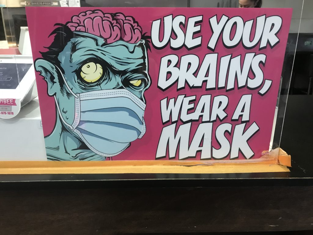 Zombee Donuts sign for requiring face masks.