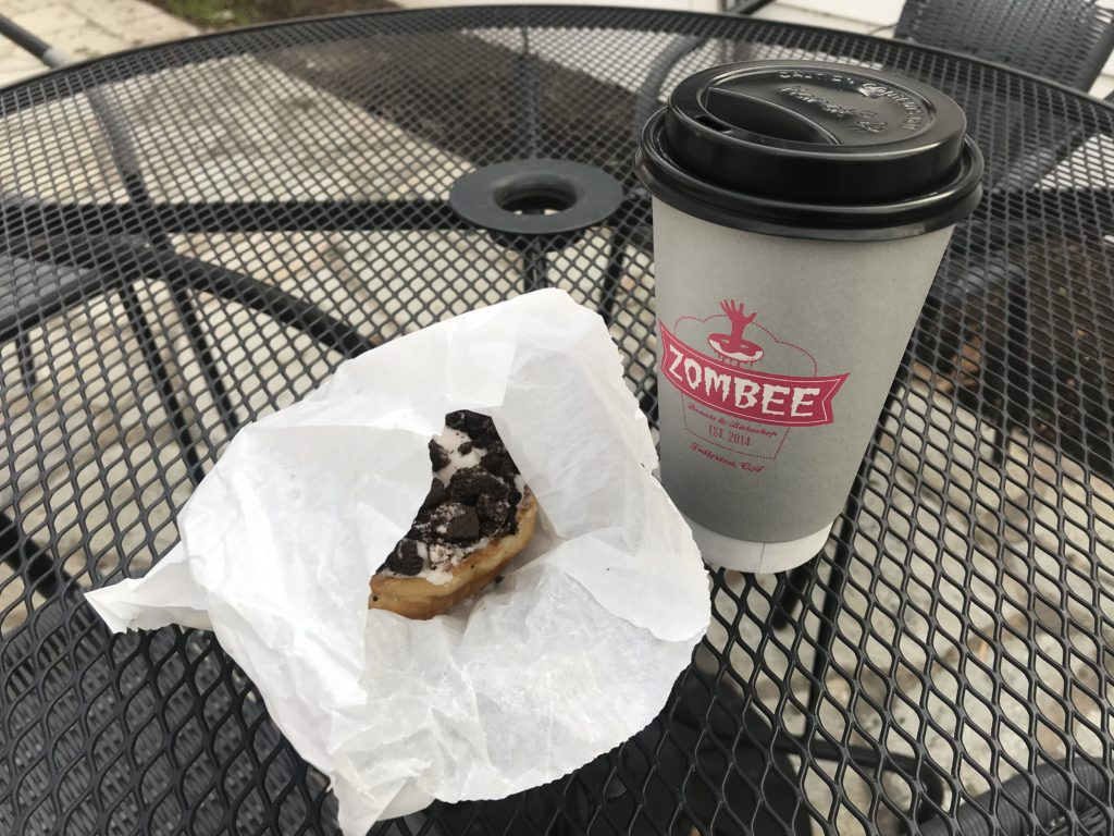 """""""Cookies n Scream"""" donut and a caramel latte."""