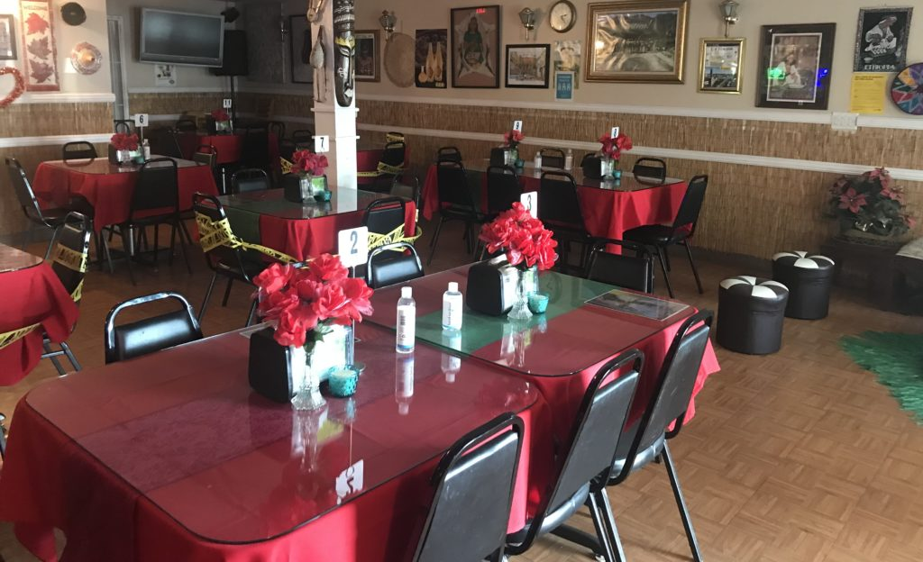 Empty tables sit in the Abyssinia Restaurant due to restaurant dining restrictions placed by the state of California.