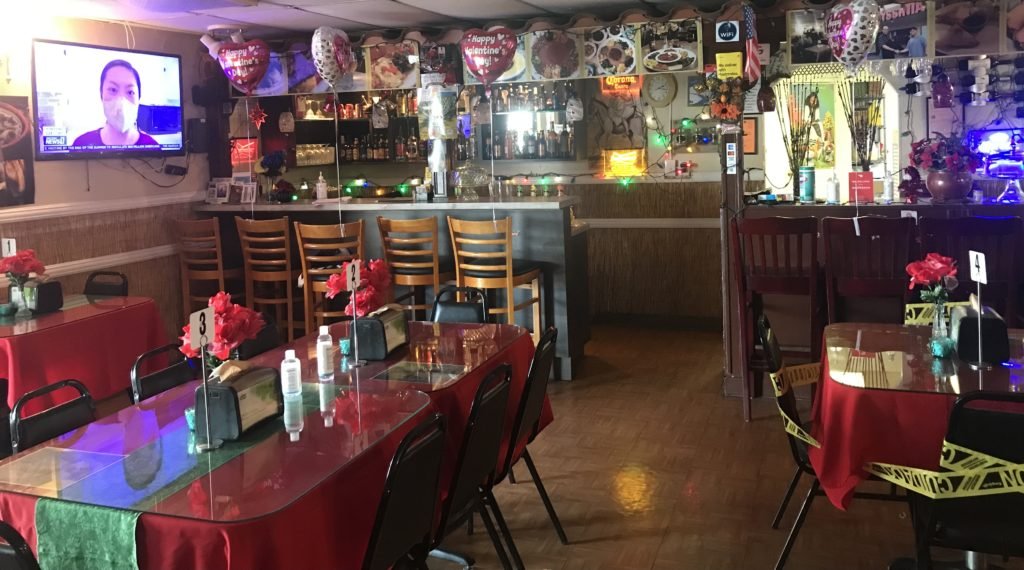 View of bar and restaurant inside the Abyssinia. Balloons were tied to chairs in celebration of Valentine's Day.