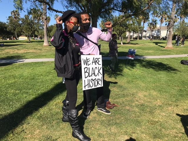 One of the main organizers, Anthony Bryson, and a Black activist posing for a photo.
