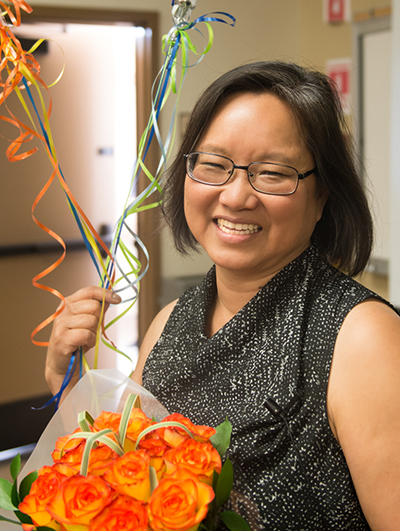 Here Dr. Jo Wen Wu is photographed with flowers after having won the award.