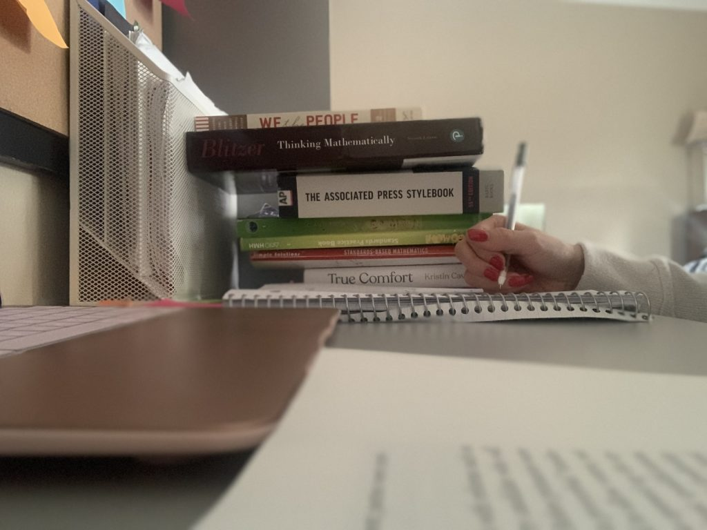 Student studying at home desk.