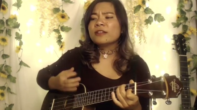 Jly (@jlymusic) performs an original song during the open mic over Zoom.