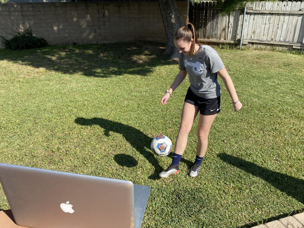 Morgan Dack practicing juggling ball while on Zoom practice.