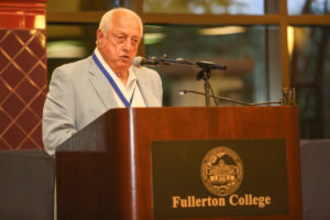 Lasorda delivers a speech after being inducted into the Hornet Hall of Fame in 2015.