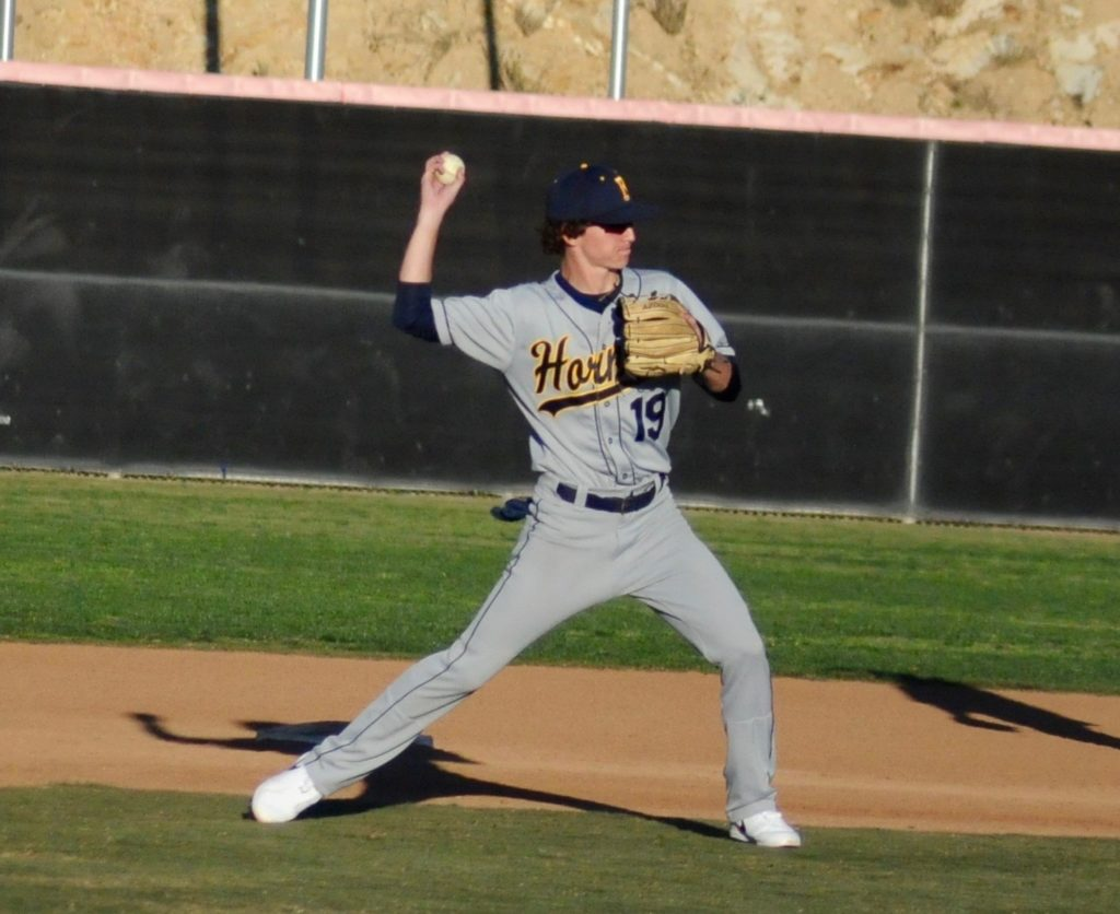 Brock Denbo making a play at shortstop, where he is projected to be one of the best in the conference this season