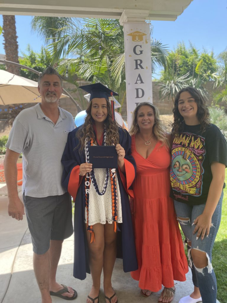 Left to right; Dad Rod, Taylor, mom Carrie and sister Devyn celebrating Taylor's high school graduation.