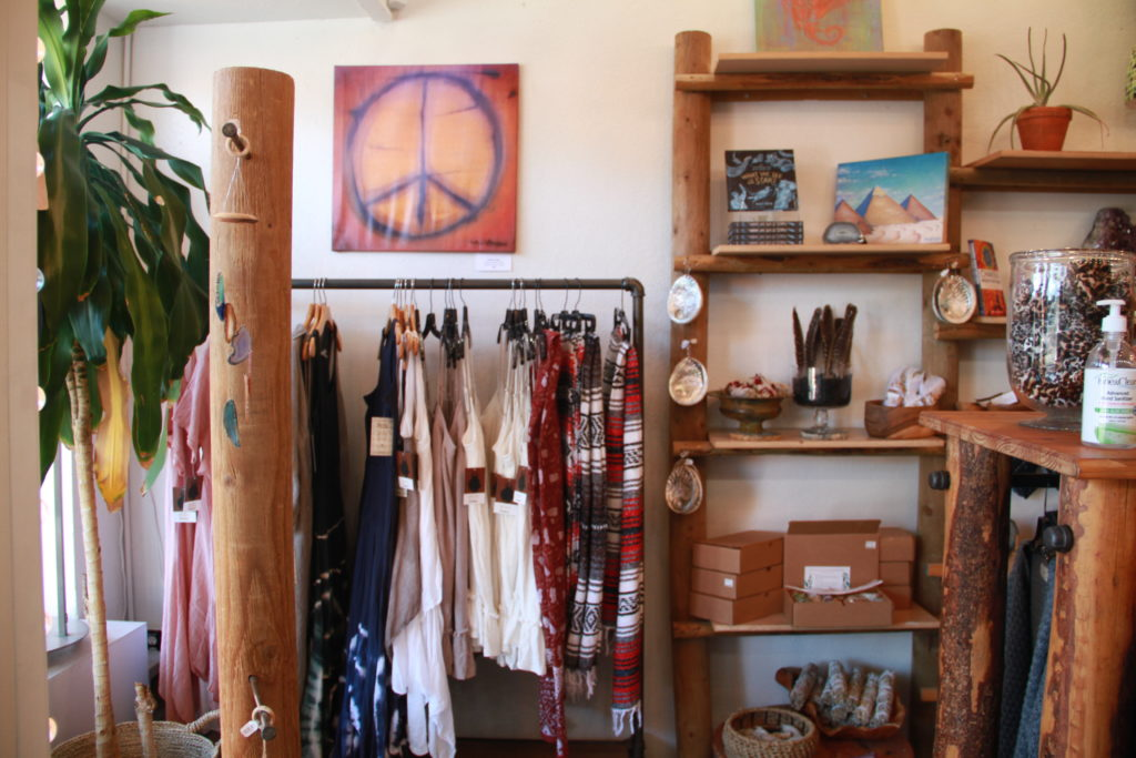 The metaphysical section of the store where crystals, artwork and sage are displayed.