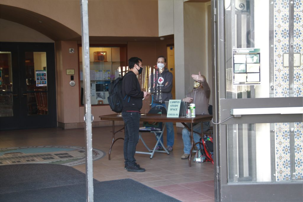 A student checks in for the on-campus study space.