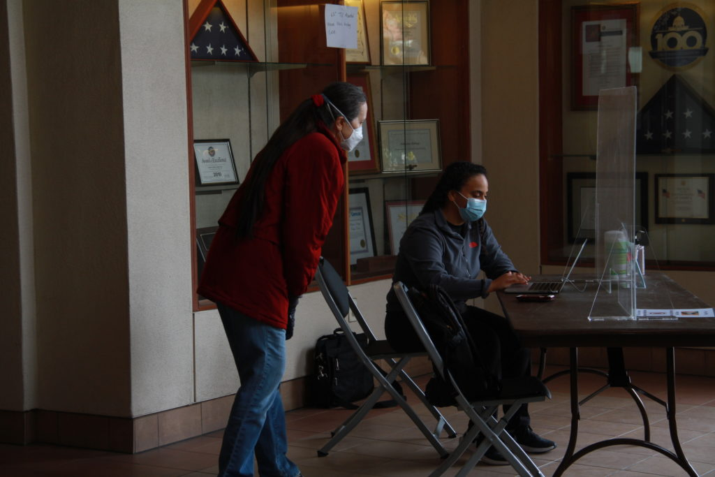 Onsiste staff working at the check in center for the on-campus study space.